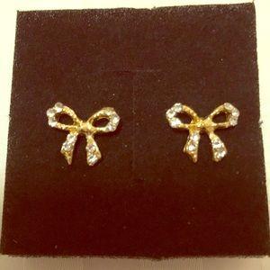 Gold tone cubic zirconia bow earrings.